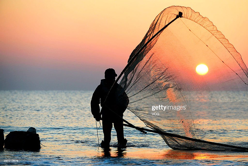 A fisherman walks on stilts while shrimping early in the morning in Shanhaitian Scenic Resort on October 13, 2015 in Rizhao, Shandong Province of China. The practice of shrimping on stilts in Shandong Province has lasted for several hundred years.