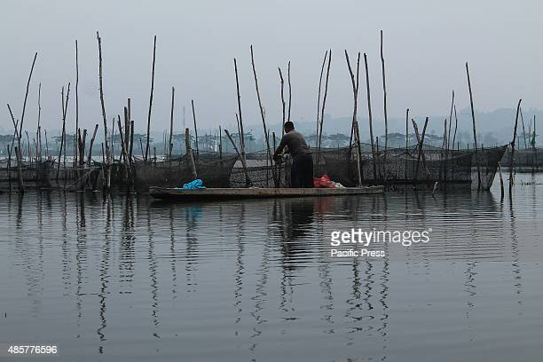 LHOKSEUMAWE ACEH INDONESIA A fisherman was feeding his fish cages at Lhokseumawe Aceh Province Bank of Indonesia expects economic growth this year to...