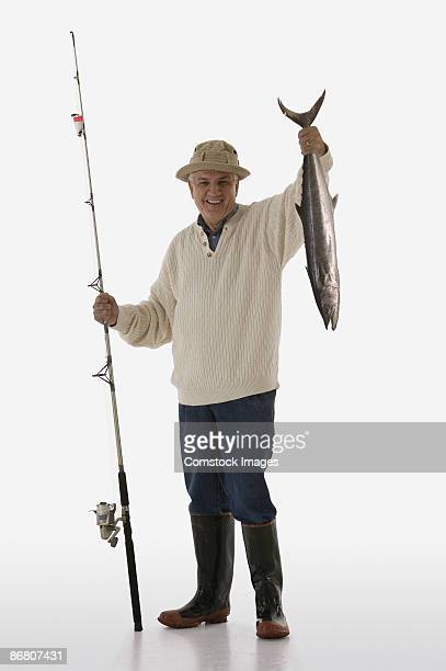 fisherman with a fish - catch of fish stock pictures, royalty-free photos & images