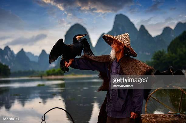 Fisherman with cormorant bird, Guilin, Guangxi, China