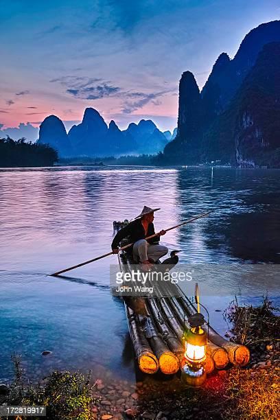 Fisherman with cormorant on Li River at sunset
