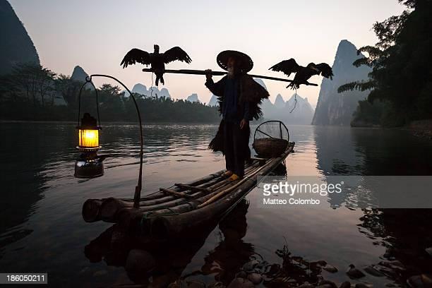Fisherman with cormorants on Li river, China