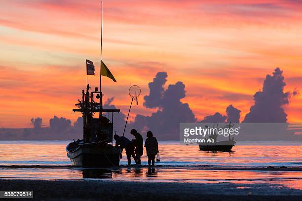 fisherman with fishing boat at sunset - prachuap khiri khan province stock pictures, royalty-free photos & images
