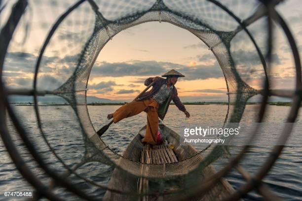 Fisherman with traditional fishing at Inle Lake, Myanmar