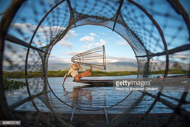 Fisherman with traditional fishing net in Inle lake, Myanmar