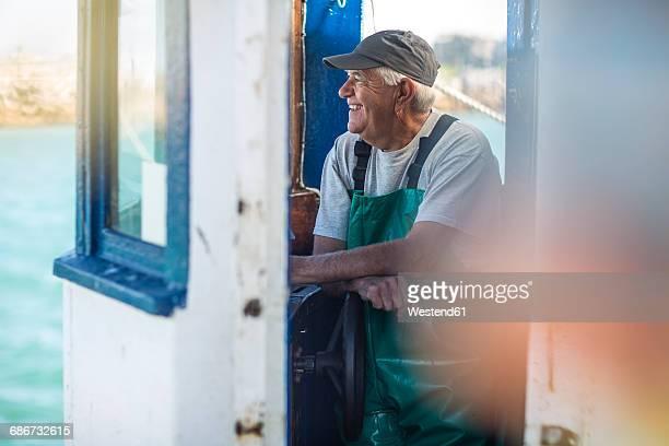 fisherman working on trawler - fischer stock-fotos und bilder