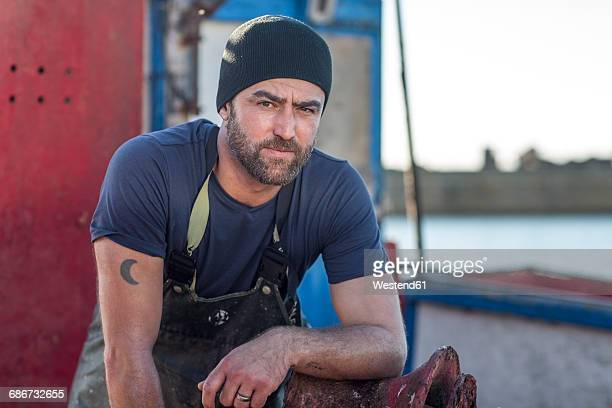 fisherman working on trawler - fisherman stock pictures, royalty-free photos & images