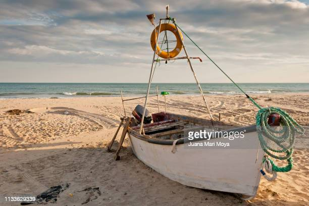 Fisherman's boat on the shore of the beach of Islantilla, Huelva.  Spain