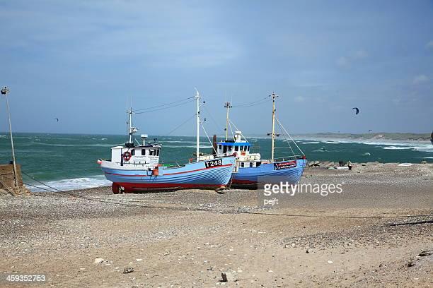 fisherman's boot am strand im nørre vorupør - pejft stock-fotos und bilder