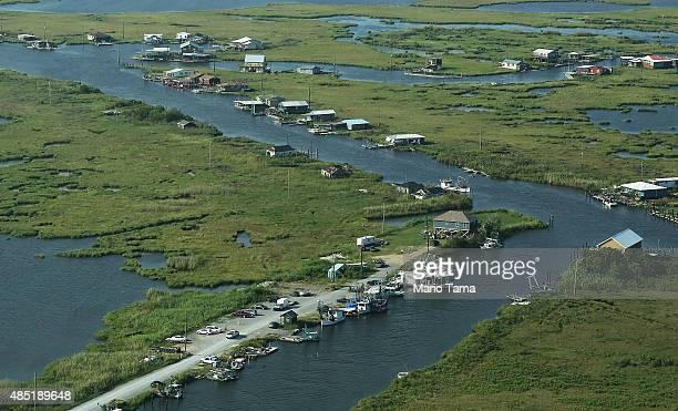 A fisherman's community stands along deteriorating wetlands on August 25 2015 in Plaquemines Parish Louisiana Louisiana is currently losing its...