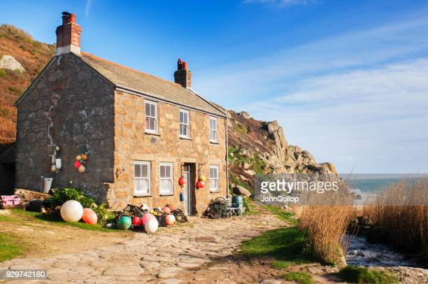 fisherman's cottage - coastline stock photos and pictures