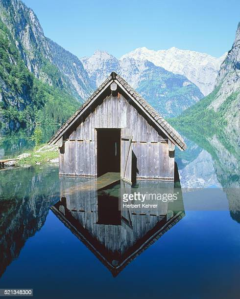 fisherman's house in the ober lake, bavaria, germany - watzmann massif stock photos and pictures