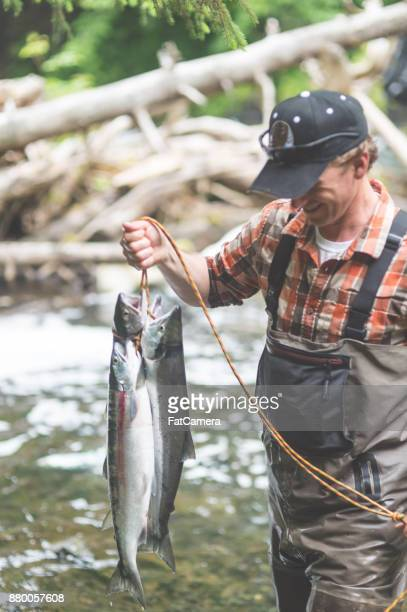 a fisherman's tale - kachemak bay stock pictures, royalty-free photos & images