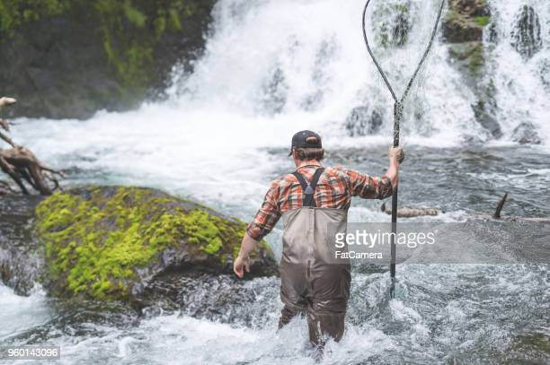 a fisherman's tale - commercial_fishing stock pictures, royalty-free photos & images