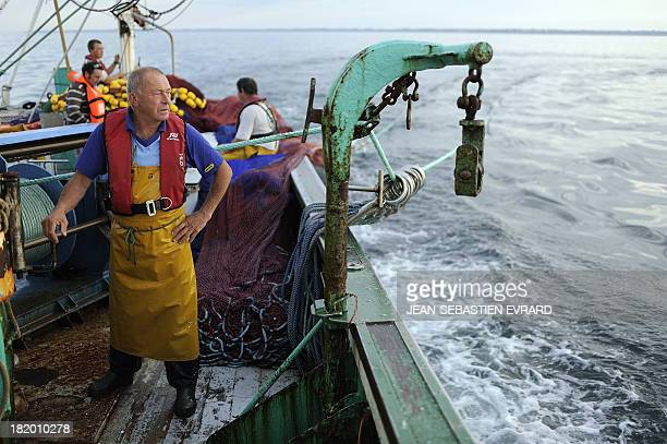 Fishermen aboard the fishing boat 'Kanedevenn' sail in search of sardines on September 24 2013 in Quiberon western France The sardines are for the...