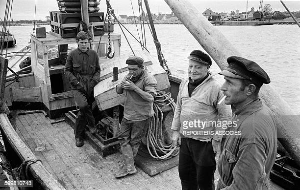 Fishermen Aboard Their Trawler in the Small Norman City of Ouistreham, France, on June 24, 1963 .
