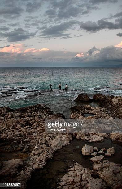 Fishermen along the corniche, at sunset, Beirut, Lebanon