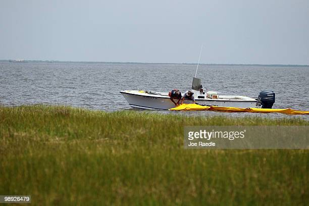 Fishermen anchor an oil boom into place in an effort to protect the coast line from the massive oil spill in the Gulf of Mexico on May 8 2010 near...