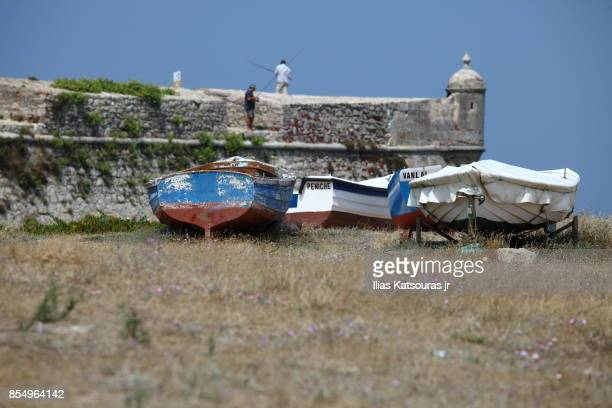 Fishermen and fishing boats on beach
