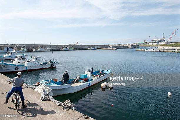 Fishermen are seen at a fishing port near a construction site for Electric Power Development Co's Oma nuclear power plant in Oma Town Aomori...