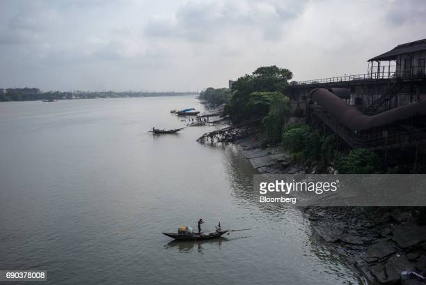 Fishermen are seen in their boats on the Hooghly river in Kolkata India on Friday May 26 2017 India is scheduled to release firstquarter gross...
