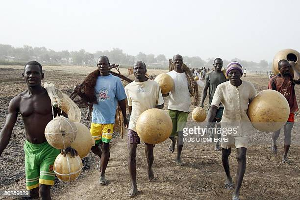 Fishermen arrive to participate in the yearly fishing festival on March 15 2008 at Argungu River in Argungu in northwestern Nigeria Over 30000...