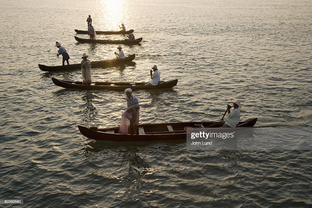 Fishermen at dawn in Cochin, India : Stock Photo