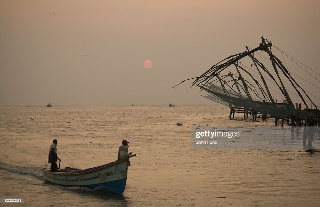 Fishermen at dawn with Chinese fishing nets : Stock Photo