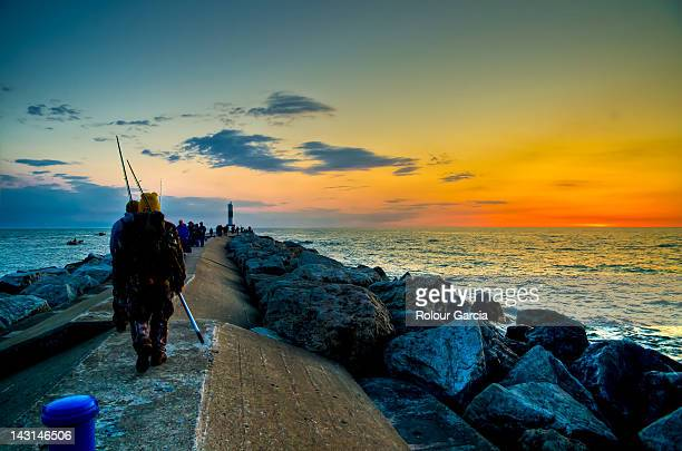 fishermen at early sunrise on sea - rolour garcia stock pictures, royalty-free photos & images