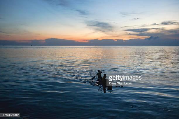 CONTENT] fishermen at sunset on Mabul Island Borneo Malaysia