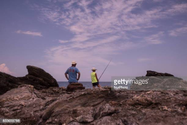 Fishermen at the beach of Plaka Greece on 25 July 2017 July 2017 It is the only place in Greece that combines the mountain's breeze with the crystal...