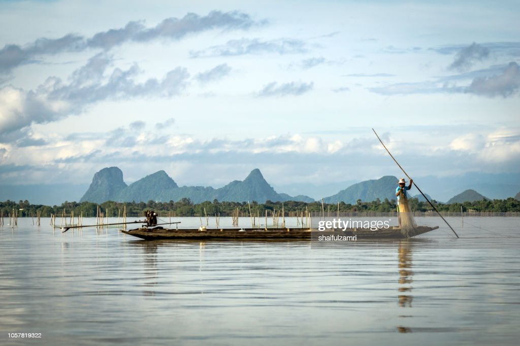 Fishermen at work in long boats, Thailand near Phatthalung province at lake Thale Noi. : Stock Photo