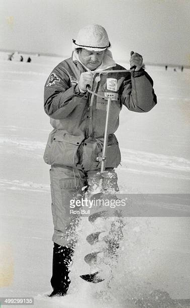 Fishermen auger for good luck A judge in striped vest sprints with Canada's Dave Morton above to his choice of a lucky hole in the ice while...