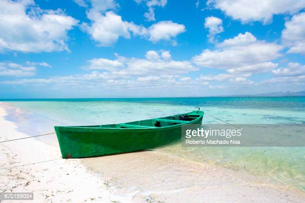 Fishermen boat in white sand and blue water beach Hidden beauty of the Caribbean island Sea surrounding 'White Key' or 'Cayo Blanco' which is an...