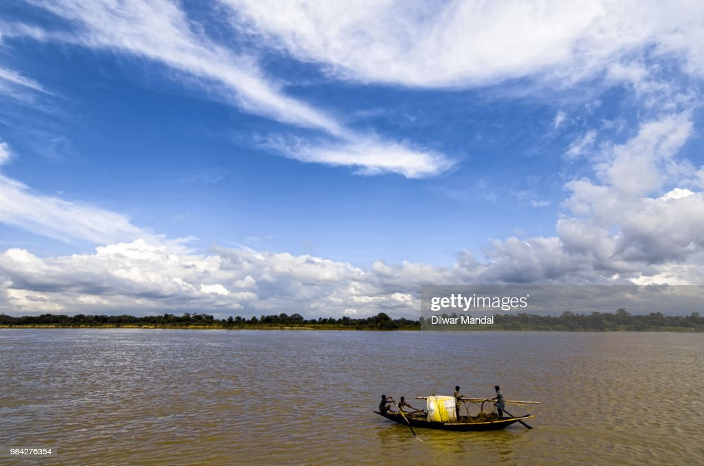 Fishermen boat sailing in Bhagirathi river : Stock Photo