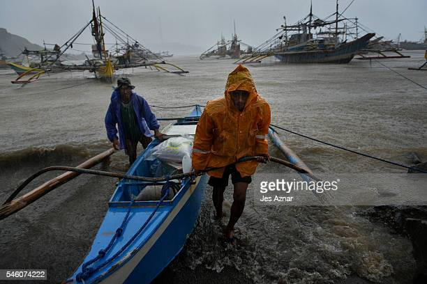 Fishermen braving heavy rains and waves to shore to prepare and resupply for another fishing trip to the Spratlys on July 9 2016 in Mariveles Bataan...