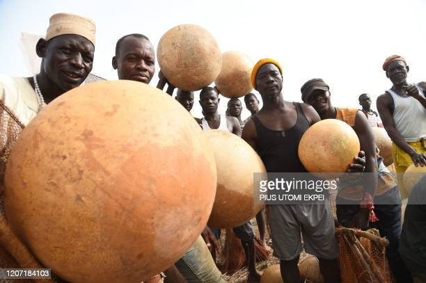 Fishermen carry calabashes preparing to attend the Argungu fishing and cultural festival at Argungu Town Kebbi State in northwest Nigeria on March 14...
