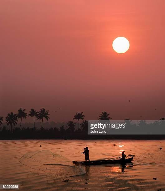 Fishermen cast a net in Cochin, India