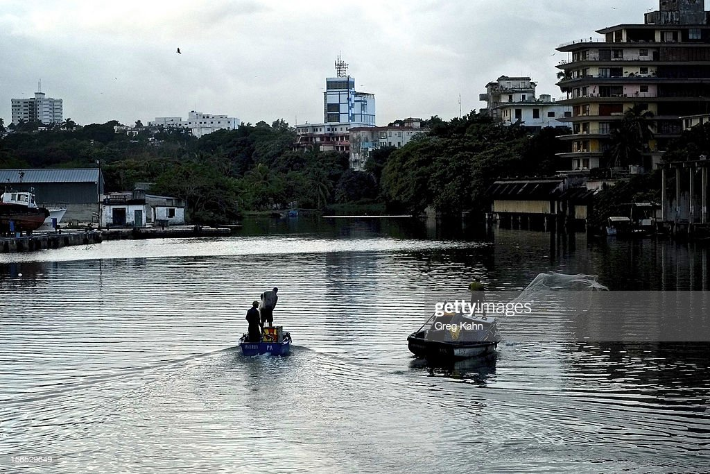 Fishermen cast nets for bait fish in the Almendares River before heading out to fish for the day November 16, 2012 in Havana, Cuba. Despite Cuba's fisheries being at critically low levels according to the United Nations, fishermen are still catching enough to make a living.