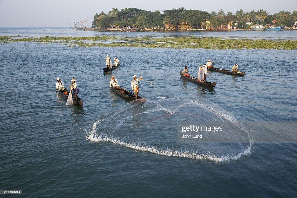 Fishermen casting net : Stock Photo