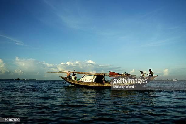 Fishermen catching fish in the Padma River Bangladesh August 9 2007