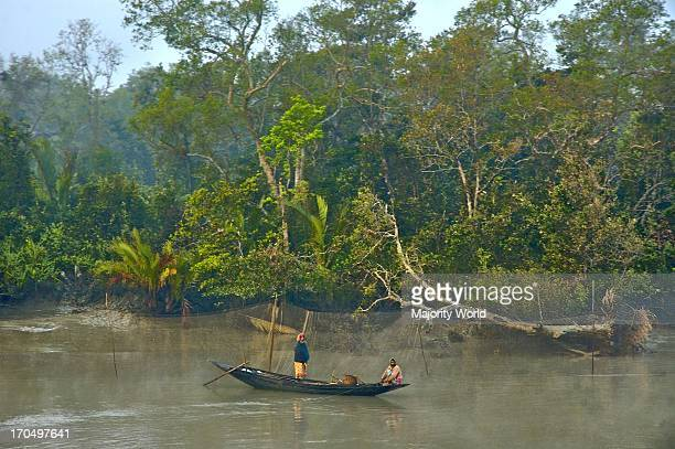 Fishermen catching fishes in a canal in the Sundarbans a UNESCO World Heritage Site and a wildlife sanctuary The largest littoral mangrove forest in...