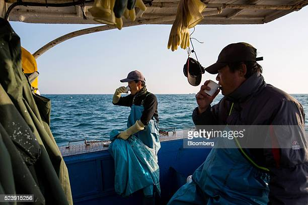 Fishermen drink coffee on a fishing boat on the sea near Namhae, South Korea, on Tuesday, April 19, 2016. South Korea is scheduled to release...