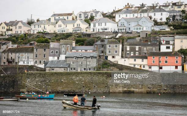 Fishermen enter the harbour in the village of Mevagissey which has submitted plans to limit the number of second homes on October 10 2017 in Cornwall...