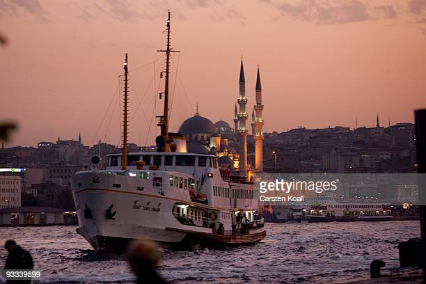 Fishermen fishing close to the ferry terminal in the district Karakoy on October 19, 2009 in Istanbul, Turkey. The Turkish metropolis on the...