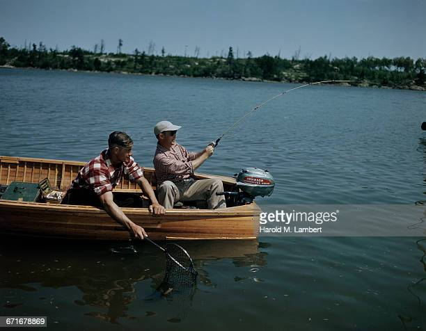 fishermen fishing in river  - number of people stock pictures, royalty-free photos & images