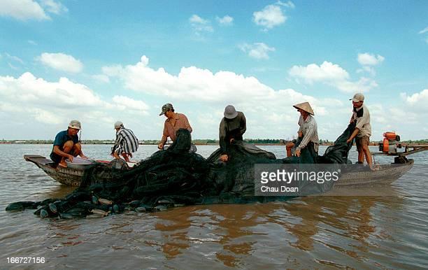 Fishermen fishing on the Hau River in Long Xuyen An Giang Vietnam