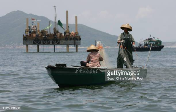 Fishermen Fung Foryau and his wife Cheung Linmui retrieve the fishing net and found no fish Cheung Chisang Chairman of Soko Islands' small boat...