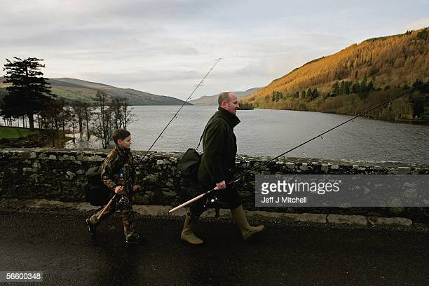 Fishermen gather at Kemore village square on the opening day of the salmon season on the River Tay on January 16, 2006 in Kenmore, Scotland. The...