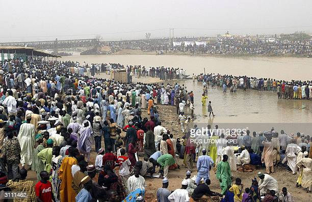 Fishermen get ready at the Argungu fishing festival 19 March 2004 in Kebbi State of northern Nigeria Thousands of fishermen took part in the mock...